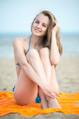 Young lady sunbathing on a beach — Stock Photo