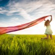 Young happy woman in wheat field with fabric. Summer lifestyle — Stock Photo #69528861