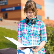Student girl with copybook on bench. Summer campus park. — Stock Photo #69529453