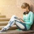 Beautiful young woman student with note pad and headphones. Outdoor student. — Stock Photo #69529825