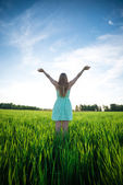 Happiness woman stay outdoor under sunlight of sunset — Stock Photo