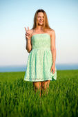 Happy vitality freedom girl stands with her hands. Playfull woman — Stock Photo