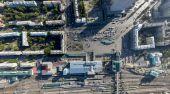 Aerial city view with crossroads, roads, houses, buildings, parks, parking lots, bridges — Stock Photo
