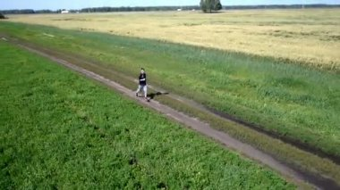 Aerial. Running athlete man. Male runner sprinting during outdoors training. — Stock Video