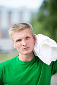 Tired man after fitness time and exercising. With white towel — Foto de Stock