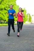 Runners training outdoors working out. City running couple jogging outside. — Stockfoto