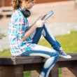 Beautiful young woman student with note pad. Outdoor student. — Stock Photo #74788981
