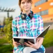 Student girl with copybook on bench. Summer campus park. — Stock Photo #79754710