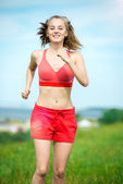 Young woman running summer park rural road. Outdoor exercises. J — Stock Photo