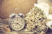 Still life with old broken alarm clock, perfume, dead flowers, t — Zdjęcie stockowe