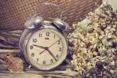 Still life with old broken alarm clock, perfume, dead flowers — Zdjęcie stockowe