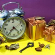 Still life with broken alarm clock, vintage key, dead rose, gift — Stock Photo #59826165