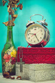 Still life with broken alarm clock, metal cross with metal neckl — Стоковое фото