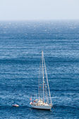 Sailboat on calm water in the bay — Stock Photo