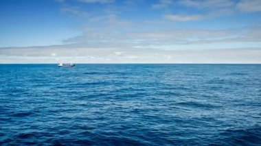 A fishing boat passing by a cruise ship on the Atlantic ocean — Stok video