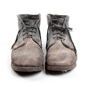 Old dirty boots isolated on white background — Stock Photo