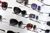 Shop shelves with sunglasses — Stock Photo