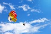 Parasailing - towed parachute against blue sky — Stok fotoğraf