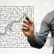 Conceptual image of businessman trying to find way out of maze — Stock Photo #57511473