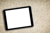 Blank digital tablet on fabric background — Stock Photo