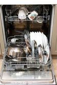 Opened dishwasher with dirty dishes — Stock Photo