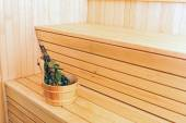 Bucket with birch broom in sauna — Stock Photo