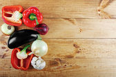 Fresh vegetables on wooden table from above with copy space — Stock Photo