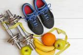 Fitness equipment and healthy nutrition on white wooden plank fl — Stock Photo