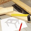 Wooden planks with tools and table draft on tablesaw — Stock Photo #70392387