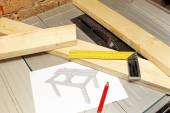 Wooden planks with tools and table draft on tablesaw — Stock Photo