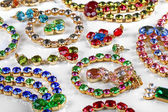 Variety of gemstone jewelry on white table — Stock Photo