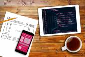 Website wireframe sketch and programming code on digital tablet — Stock Photo
