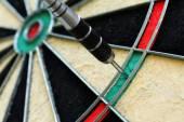 Close up view of dart and dartboard — Stock Photo