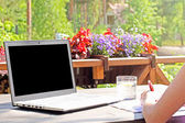Work from home, table with laptop on terrace — Stock Photo