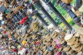 Lot of wedding padlocks on bridge railings, love forever concept — Stock Photo