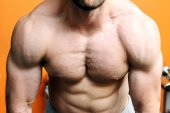 Muscular fitness model torso in gym — Stock Photo