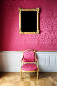Vintage style interior with chair and blank picture on the wall — Stock Photo