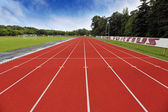 Stadium arena with football field and racing tracks — Stock Photo