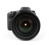 Closeup of black photo camera isolated on white — Stock Photo