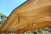 Wooden roof construction of outdoor carport — Stock Photo