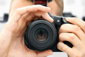 Front view of man holding camera — Stock Photo