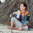Fashion handsome man relaxing on beach — Stock Photo #59018779