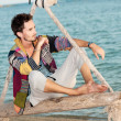 Fashion handsome man relaxing on beach — Stock Photo #59019065