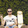 Handsome guy in sunglasses and  board — Stock Photo #74965689