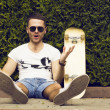 Handsome guy in sunglasses and  board — Stock Photo #74965741