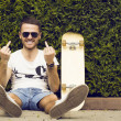 Handsome guy in sunglasses and  board — Stock Photo #74965815