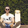 Handsome guy in sunglasses and  board — Stock Photo #74965823