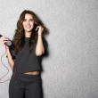 Girl with glamorous look poses with earphones — Stock Photo #75147205
