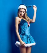 Beautiful fashion woman in Snow Maiden suit poses on blue background — Stock Photo