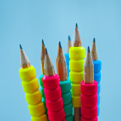 Row of color pencils on blue  background.Studio shot — Stock Photo